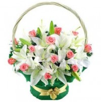 Basket arrangement of Exotic White Lilies and Pink Roses.