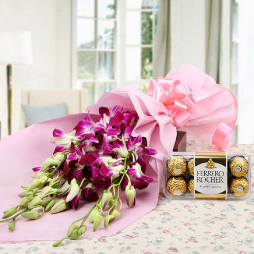 purple Orchids neatly wrapped in matching paper packing and   Ferrero Rocher chocolate