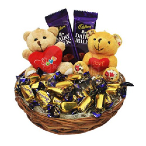 2 teddies 6 inches each along with 2 Dairy milk and 30 Cadbury Eclairs.
