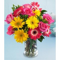 MIX FLOWERS IN A GLASS VASE