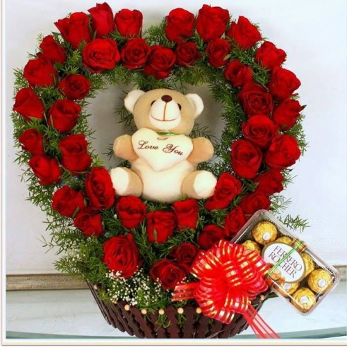 Red Rose Heart shape arrangement in wooden basket + small teddy with chocolates